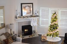 Free Green And White Pre-lit Pine Tree Near Fireplace Inside Well Lit Room Royalty Free Stock Photography - 109912397