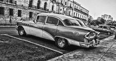 Free Greyscale Photo Of Vintage Car Parked Beside Building Royalty Free Stock Photos - 109912478