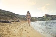 Free Woman Wearing Grey Bikini Running On White Sand Seashore Stock Photos - 109912613