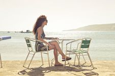 Free Woman Sitting On Armchair Near Seat Royalty Free Stock Images - 109912679