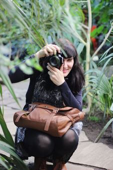Free Woman Taking Picture While Holding Brown Leather Bag Stock Image - 109912731