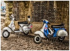 Free White And Blue Scooter Motorcycles Royalty Free Stock Image - 109912976