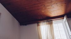 Free Beige Window Curtain On White Window Panel Stock Image - 109913201