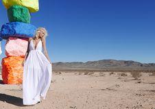 Free Woman In White Halter Neckline Deep V-neck Dress Standing Royalty Free Stock Photo - 109913205