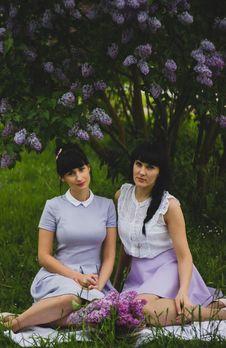 Free Two Women Wearing Purple Dress Sitting Side-by-side On Grass Field Royalty Free Stock Images - 109913399
