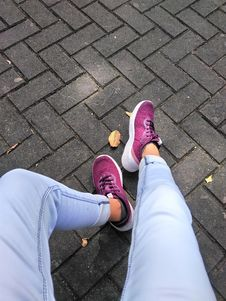 Free Person Wears Purple Low-top Sneakers Royalty Free Stock Photography - 109913437