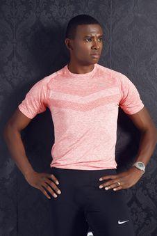 Free Man Wearing Pink Crewneck Shirt And Black Nike Shorts Standing Royalty Free Stock Photography - 109913627