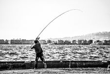 Free Grayscale Photography Of Man Holding A Fishing Rod Near Body Of Water Stock Image - 109913641