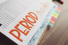 Free Period Trackers Written On Graphing Notebook Stock Image - 109913751