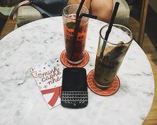 Free Photo Of Blackberry Phone Beside Two Tall Glasses Royalty Free Stock Photo - 109913765