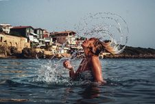 Free Time-lapse Photography Of Woman Playing On Water With Her Hair Stock Photo - 109913840