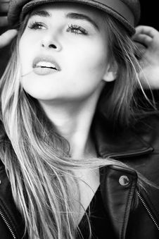Free Grayscale Photography Of Woman Wears Leather Jacket And Cap Stock Images - 109913874