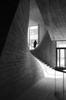 Free Person Standing Near Window Inside Building Near Stairs Grayscale Photo Stock Photos - 109913893