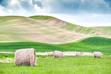 Free Several Hay Rolls On Grass Field Within Mountain Range Stock Photography - 109913932
