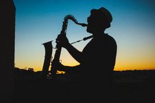 Free Silhouette Of A Man Playing Saxophone During Sunset Royalty Free Stock Photo - 109914045
