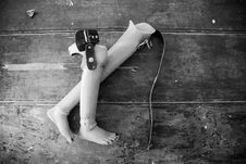Free Two Prosthetic Legs On Wooden Surface Royalty Free Stock Image - 109914046