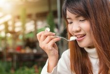 Free Woman Holding Spoon Trying To Eat White Food Stock Image - 109914081