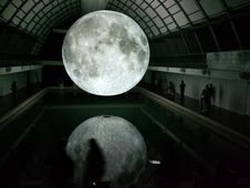 Free Photo Of Moon Hologram Floating On Water Near People Inside Room Stock Image - 109914111