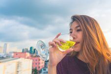 Free Woman In Purple Top Drinking On Clear Wine Glass Royalty Free Stock Image - 109914146