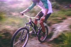 Free Man Riding Black And White Hardtail Mountain Bike Stock Image - 109914191