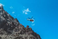 Free Photography Of White And Red Helicopter Flying Stock Photography - 109914232