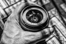 Free Grayscale Photography Of Person Holding Dslr Zoom Lens Royalty Free Stock Photo - 109914275