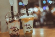 Free Two Liferia Hello Coffee Drinks On Brown Wooden Table Royalty Free Stock Image - 109914356