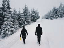 Free Photograph Of Two Persons In The Middle Of The Road On A Snowy Setting Stock Photography - 109914442