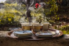 Free Brown Ceramic Teacups Beside Saucers On Brown Serving Plate Stock Photography - 109914472