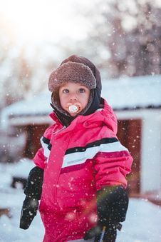 Free Toddler Boy Wearing Red And Black Winter Jacket And Gray Ushanka Hat Standing On Snow Covered Field Stock Photo - 109914510