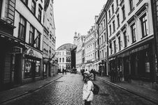 Free Grayscale Photo Of A Woman Between Buildings Photo Royalty Free Stock Photo - 109914625