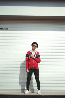 Free Man In Red And Black Zip-up Jacket And Black Pants With Black Hat Stock Images - 109914664