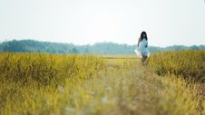 Free Depth Of Field Photography Of Woman Wearing White Sleeveless Dress Standing On Green Grass Field Stock Images - 109914684