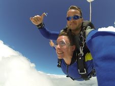Free Man And Woman In Blue Jacket Doing Sky Diving Stock Photo - 109914690