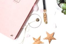 Free Silver-colored Open-end Bracelet Beside Two Brown Stars Ornament Stock Images - 109914754