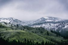 Free Green Mountain Covered By Snow Stock Photography - 109914932