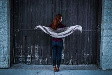 Free Woman Holding Gray Shawl While Spreading Her Arms Infront Of Brown Wooden Door Stock Images - 109914964