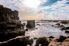 Free Landscape Photography Of Rocks Surrounded By Body Of Water Royalty Free Stock Photo - 109914985