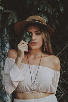 Free Woman In Crop Top Holding Leaf Covering Right Eye Stock Photo - 109915010