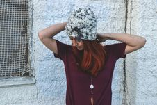 Free Woman In White And Black Knit Cap Posing Near White Wall Royalty Free Stock Images - 109915099