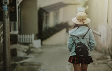 Free Girl In Blue Jacket And Black Leather Knapsack Walking On Street Royalty Free Stock Photo - 109915285