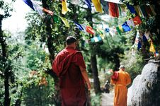 Free Two Monks Walking Between Trees Stock Photo - 109915330