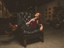 Free Woman Sitting On Black Leather Armchair Stock Image - 109915561
