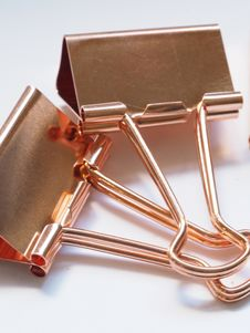 Free Two Gold Binder Clips Royalty Free Stock Image - 109915716