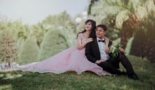 Free Nuptial Photo Of Man In Black Formal Suit And Woman In Pink Gown Stock Image - 109915891