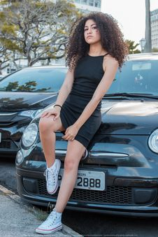 Free Woman In Black Spaghetti Strap Dress And White Converse All-star High-top Royalty Free Stock Photos - 109915958