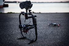Free Shallow Focus Photography Of Black Quadcopter Near Body Of Water Stock Image - 109916011