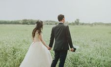 Free Woman In White Wedding Dress Holding Hand To Man In Black Suit Royalty Free Stock Image - 109916066