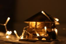 Free Turned On String Light On Miniature House Royalty Free Stock Images - 109916189