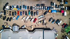 Free High-angle Photo Of Vehicles Parked Near Building Stock Photos - 109916243